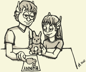 Under the instruction of an adult Elf, a child Elf learns to match a stuffed bunny with a flash card with the word 'Bunny' on it